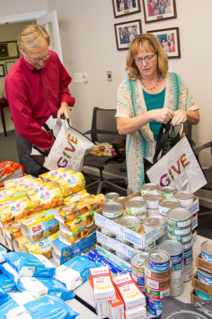 Photograph of ASWB staff assembling bags of food to donate