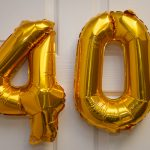 Balloons in the shape of the numerals 4 and 0