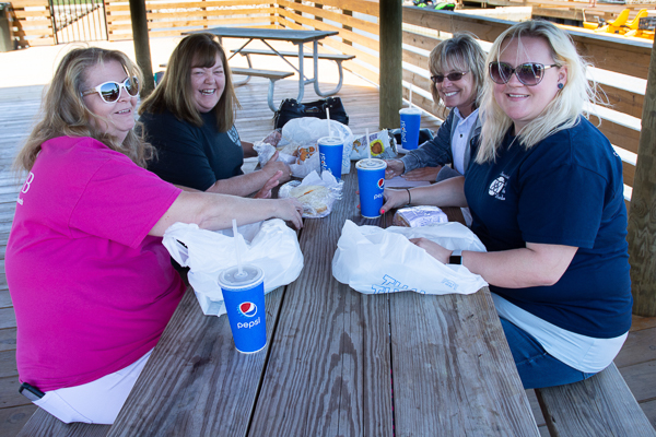 Photograph of ASWB staff eating lunch at a picnic table