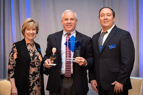 Photograph of 2019 ASWB Contributor Award Winner Ric Reamer, CEO Mary Jo Monahan, and President Timothy Martel Brown