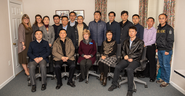 Group photo of ASWB staff members and a delegation from China
