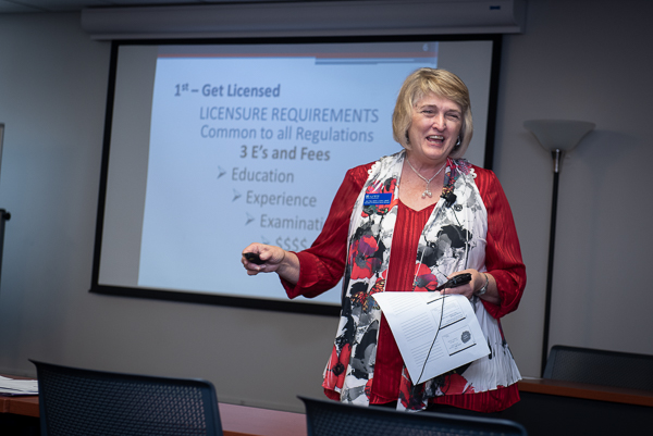 Photograph of Jan Fitts giving a presentation