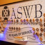 Photograph of a display featuring ASWB logo and donuts.